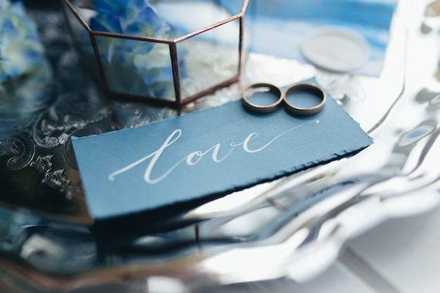 Wedding rings at wedding invitation with decorations. high quality photo