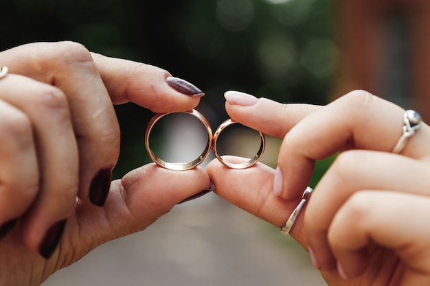 Wedding rings.wedding rings in hands.  marriage, family relationships, wedding paraphernalia.