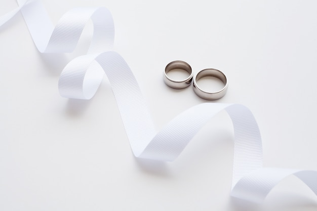 Wedding rings and white ribbon