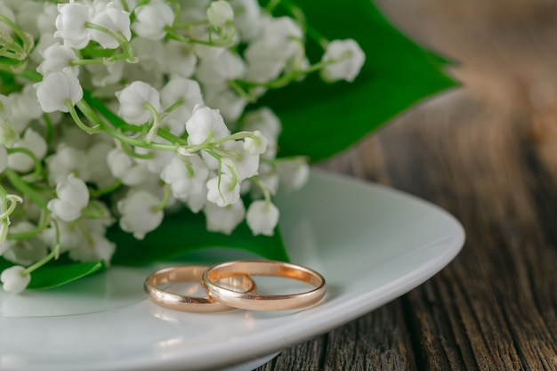 Wedding rings with flower background