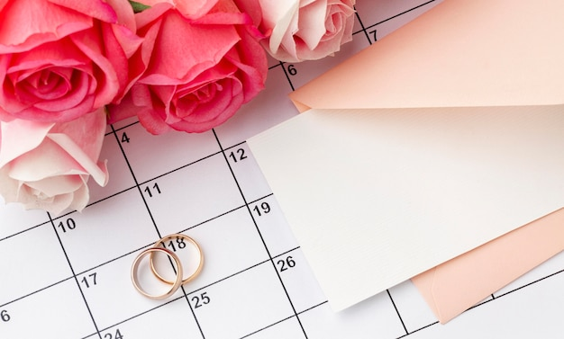 Wedding rings with flowers on calendar