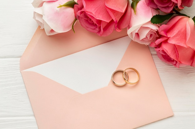 Wedding rings with flowers on envelope
