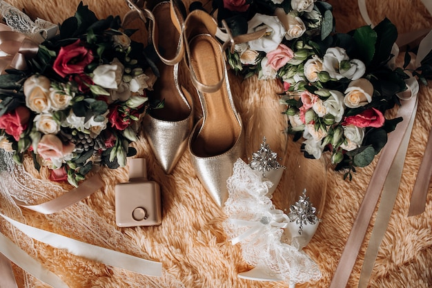 Wedding shoes for bride, wedding bouquets, perfume, precious engagement ring with gemstone