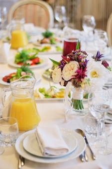 Wedding table decor. beautiful table set for an event party or wedding reception
