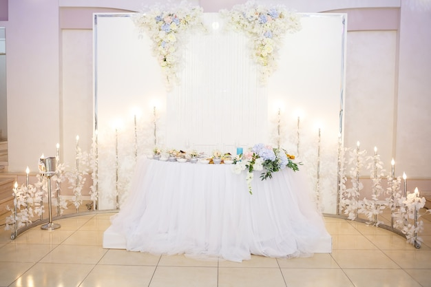 Wedding table for newlyweds with beautiful decorations