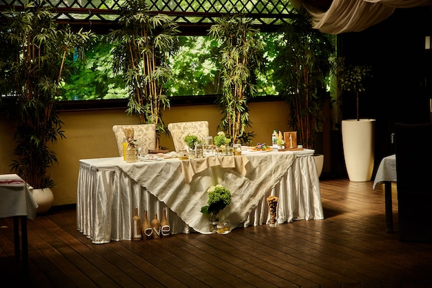 Wedding table in rustic style, decorations made of wood and wildflowers served on the festive table