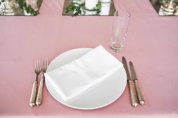 Wedding table setting newlyweds decorated with fresh flowers