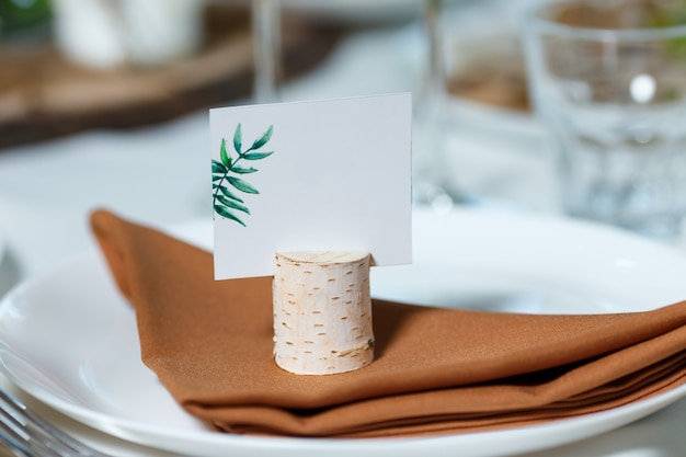 Wedding table setting with blank guest card on a dish