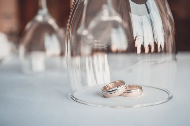 Wedding . wedding day. two gold wedding rings isolated on white  close up. just married