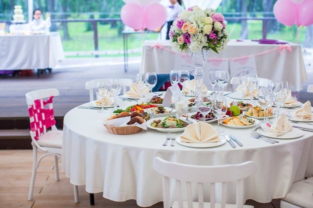 Wedding white banquet tables prepared for celebration