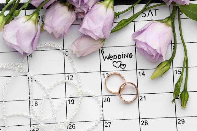 Wedding with two hearts written on calendar and rings
