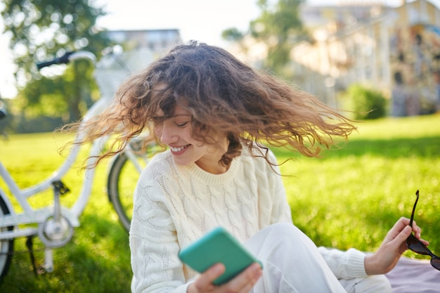 Weekend. a girl with a smartphone in hands feeling wonderful