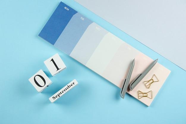 Weekly planner or calendar on blue