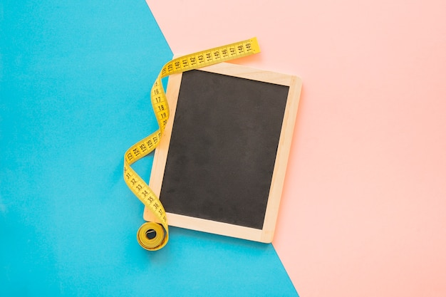 Weight loss composition with tape measure next tot slate
