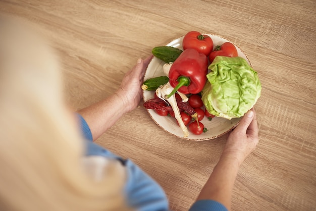 Weight loss diet hands of woman offer vegetables.