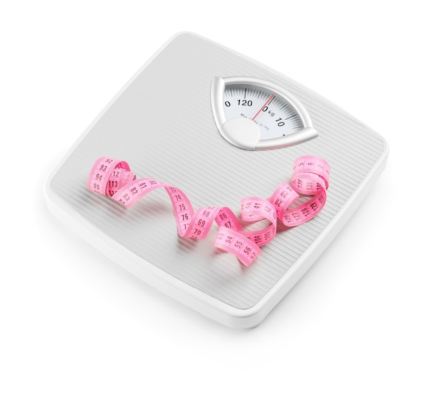 Weight scales with measuring tape. slimming concept