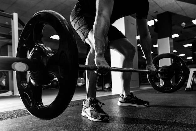 Man pulling up a barbell