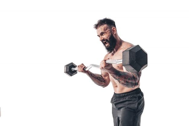 Weigthsで演習を行う筋肉ボディービルダー男
