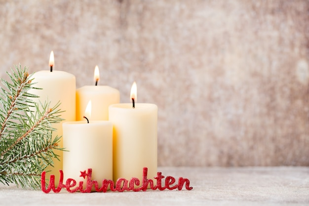 Weihnachten text with christmas candles and lights. christmas background.