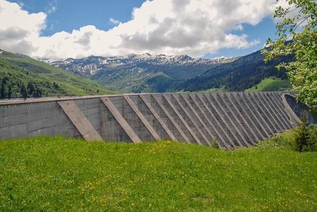 Weir and lake of roselend in french alps