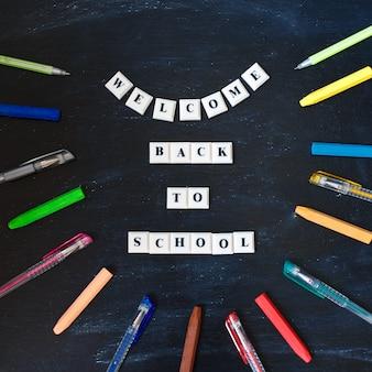 Welcome back to school lettering on blackboard