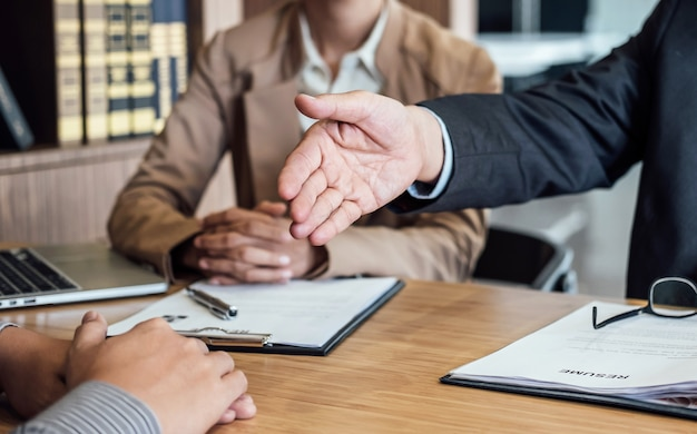 Welcome to colleagues, two senior manager shaking hands after during job interview