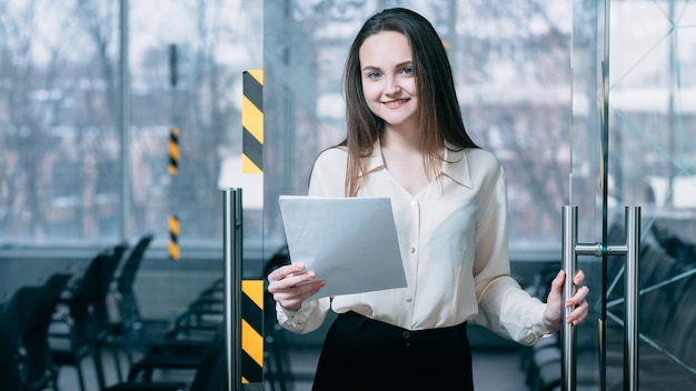 Welcome to job interview. we are hiring. friendly corporate hr female opening office door for virtual applicant.