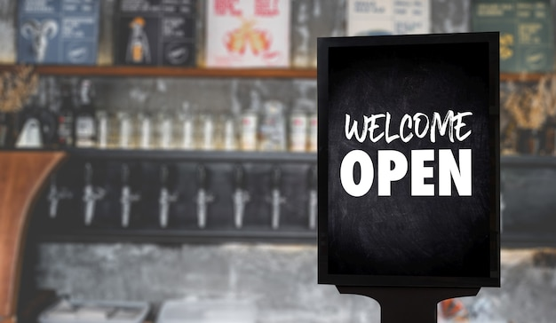 Welcome open sign in cafe or restaurant
