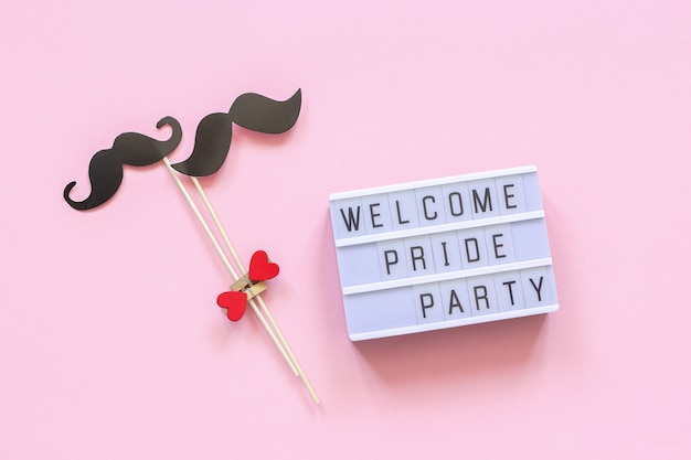 Welcome pride party and couple paper mustache props.