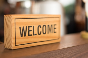 Welcome sign on the counter shop, business concept.