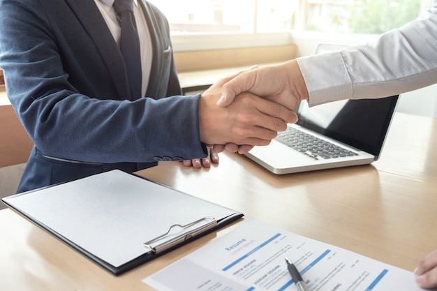 Welcome to team business people handshake with executive manager to sign approval
