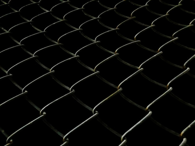 Welded mesh fence at night