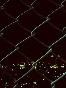 Welded mesh fence with night view