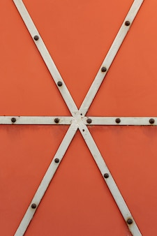 Welded metal strips with rusty rivets