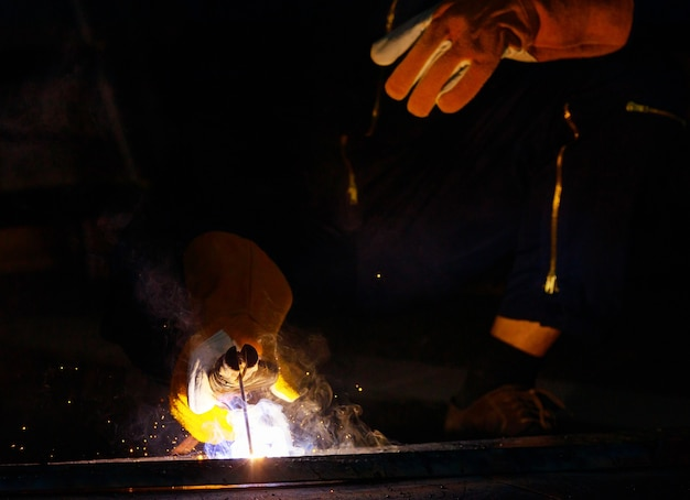Welder is welding steel together to make it stronger. work produces bright sparks have smoke, effect form light plus smoke make it looks beautiful blue light. arc is a specialized that requires skill.