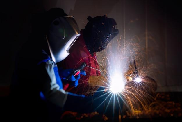 Welder in welding pipe