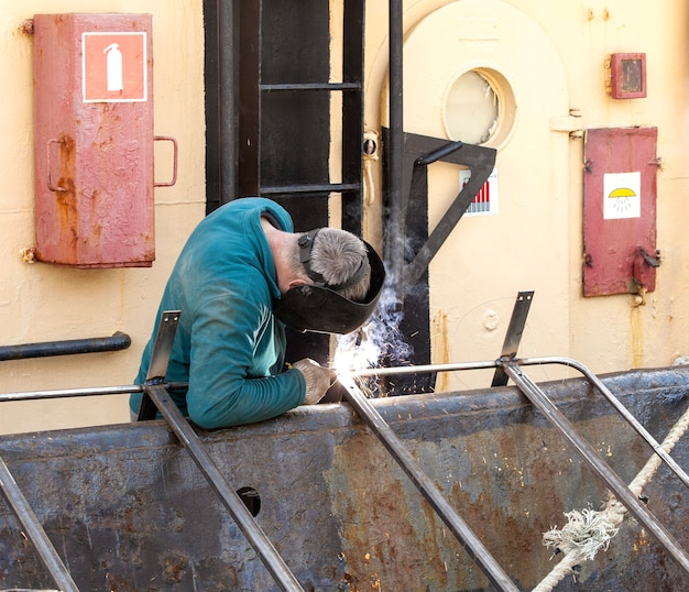 A welder working on a repair ship on kamchatka