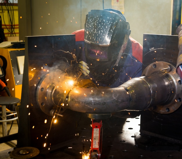 Welder working with steel