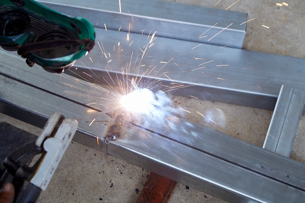 The welders are welding steel in the factory