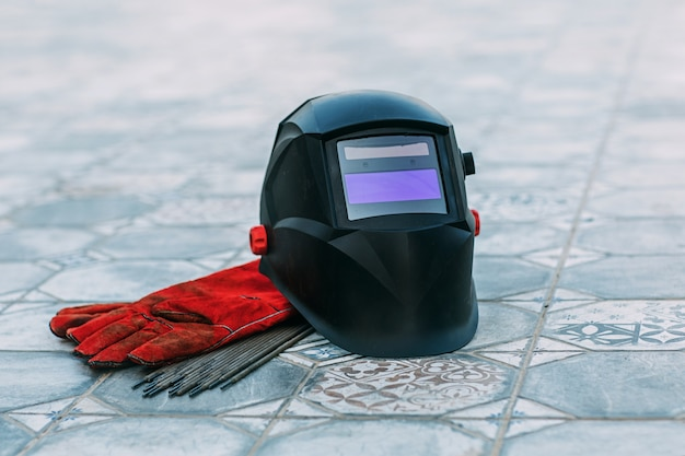 Welding mask, leather gloves, welding electrodes, a set of accessories for arc welding.
