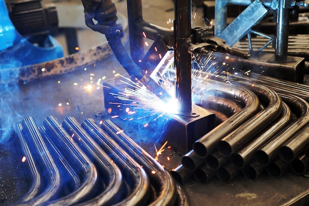 Welding steel and bright sparks in steel construction industry.