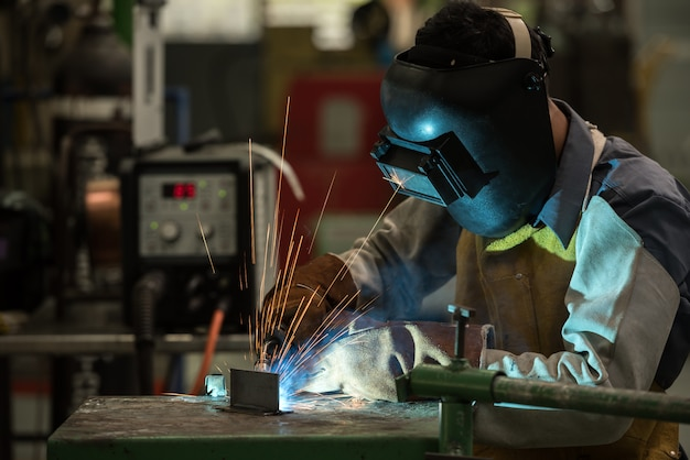 Welding worker in factory