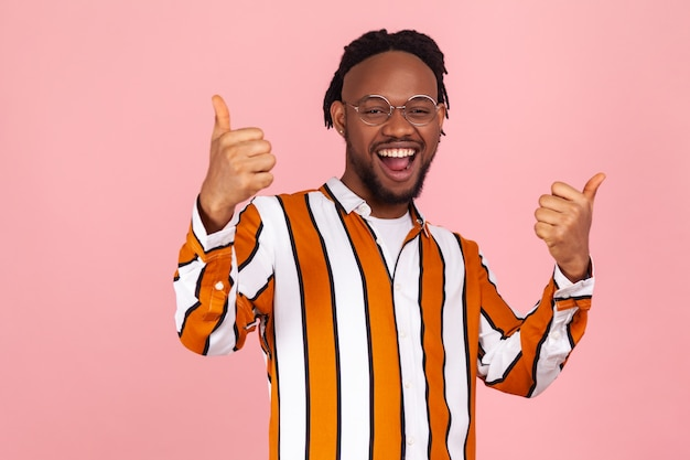 Well done! extremely excited happy afro-american man showing thumbs up gesture,
