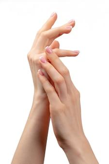 Ухоженные женские руки с маникюром на белом
