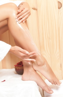 Well-groomed woman's legs in a spa after a treatment