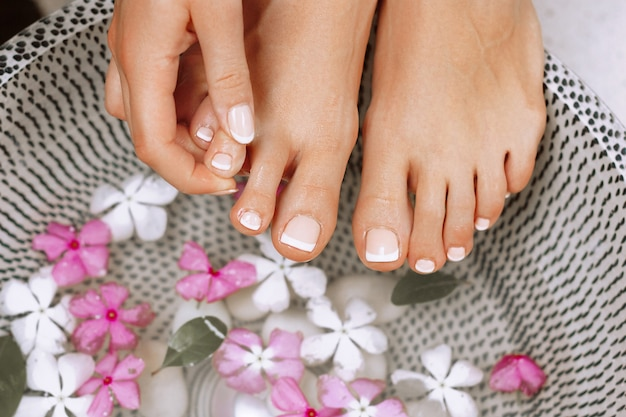 Well manicured and pedicured nails. spa treatment and product for woman feet  .