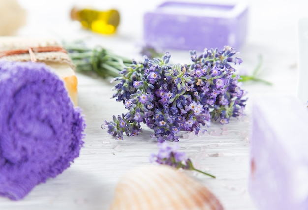 Wellness treatments with lavender flowers on wooden table