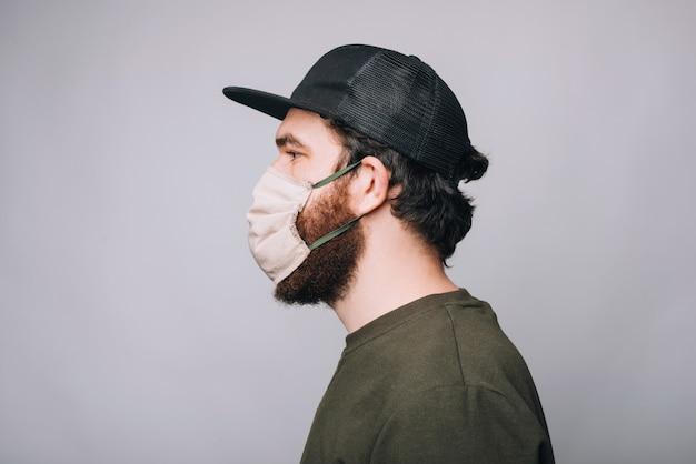 Фото вида сбоку бородатый человек бородатый человек wering маска для защиты анти ковидная