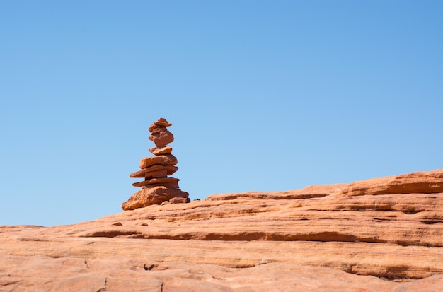 Western landscape stone pyramid made from red rocks in grand canyon with blue sky background