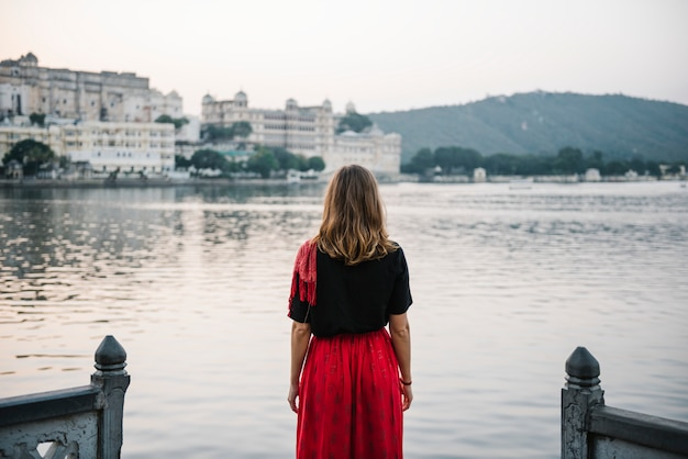 Western woman enjoying a view of taj lake in udaipur